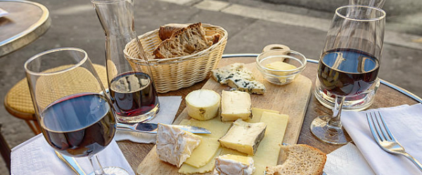Cheese_wine_and_bread_in_a_sidewalk_cafe_in_Paris